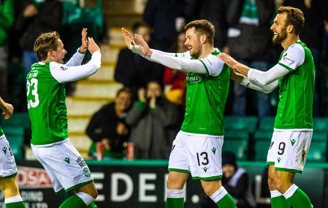 Hibs' Marc McNulty is congratulated by Scott Allan (L) after making it 1-0 during a Ladbrokes Premiership match between Hibernian and Ross County at Easter Road on February 12
