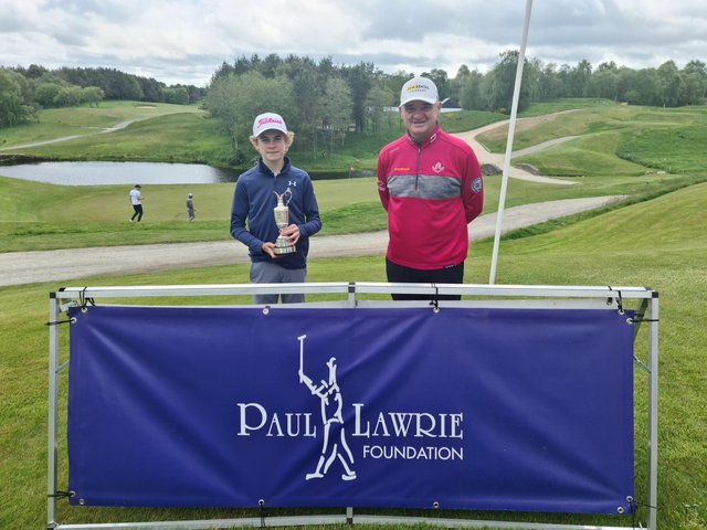 Blairgowrie's Cnnor Graham shows off the Junior Claret Jug after being presented with it by Paul Lawrie at Newmachar. Picture: Paul Lawrie Foundation