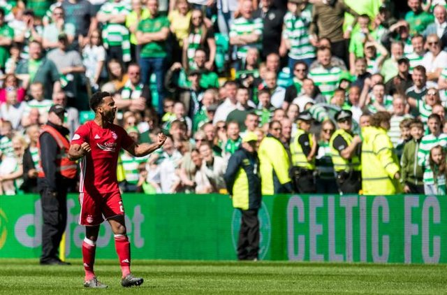 Aberdeen's Shay Logan gestures to the Celtic fans (Picture: SNS)