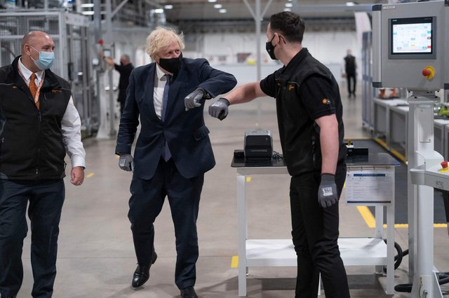Britain's Prime Minister Boris Johnson tours the facility with managing director Jeff Pratt (left) as he meets a member of staff during a visit to the UK Battery Industrialisation Centre in Coventry. Picture: AFP via Getty Images       West Midlands. 15th July 2021 (Photo by David Rose / POOL / AFP) (Photo by DAVID ROSE/POOL/AFP via Getty Images)