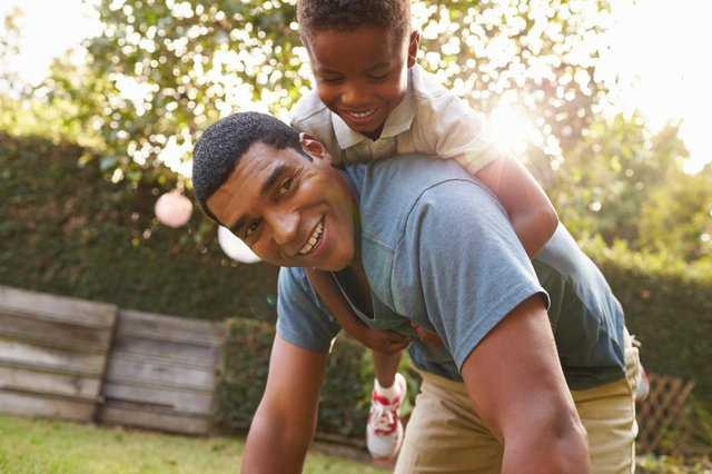Many people make a special effort to visit their dad on Father's Day, often taking a card and perhaps a gift, while activities are also common. (Pic: Shutterstock)