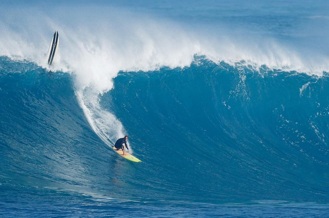 A surfer rides a wave at Waimea Bay on 15 January, 2021 in Haleiwa, Hawaii. PIC: Cliff Hawkins/Getty Images