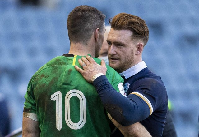 Scotland's Stuart Hogg with Johnny Sexton at full time during the Guinness Six Nations match between Scotland and Ireland at BT Murrayfield, on March 14 in Edinburgh, Scotland.  (Photo by Ross MacDonald / SNS Group)