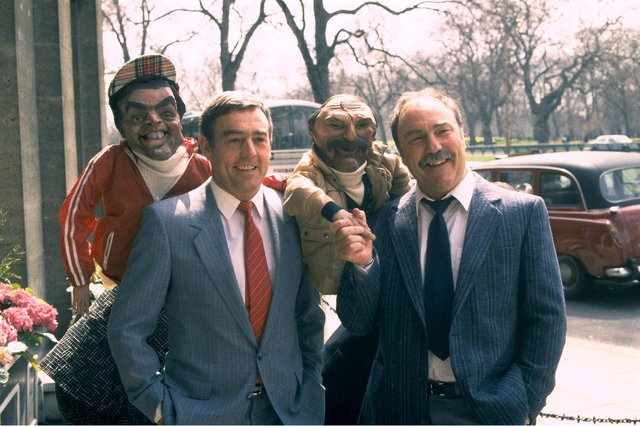 Ian St John, left, and Jimmy Greaves meet their own puppets from satirical show Spitting Image in 1989 (Picture: ITV/Shutterstock)