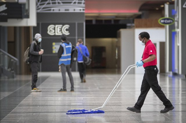 The main concourse area is cleaned at the decommissioning of the NHS Louisa Jordan hospital at the SEC, Glasgow.  Picture date: Thursday April 8, 2021.