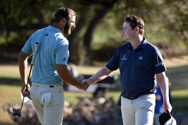 World No 1 Dustin Johnson shakes hands with Bob MacIntyreafter a tie in their match during the World Golf Championships-Dell Technologies Match Play at Austin Country Club in Texas at the end of March. Picture: Steve Dykes/Getty Images.