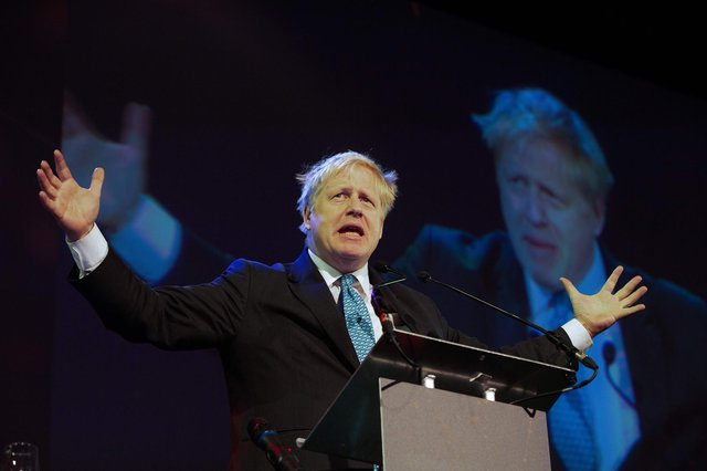 """Britain's Conservative MP and former foreign minister Boris Johnson delivers a speech entitled """"Opportunity in Uncertainty"""" at the Pendulum Summit 2019 conference at the Convention Centre in Dublin on January 10, 2019. (Photo by PAUL FAITH/AFP via Getty Images)"""
