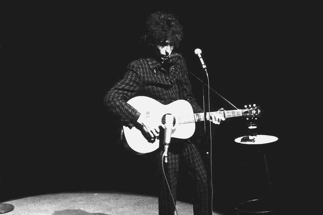 Bob Dylan performs on stage at the Olympia Theater in Paris May 25, 1966.