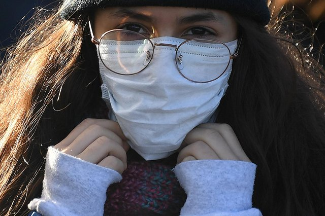 Face masks can sometimes make conversations more difficult to understand, says Bill Jamieson (Picture: Daniel Leal-Olivas/AFP via Getty Images)