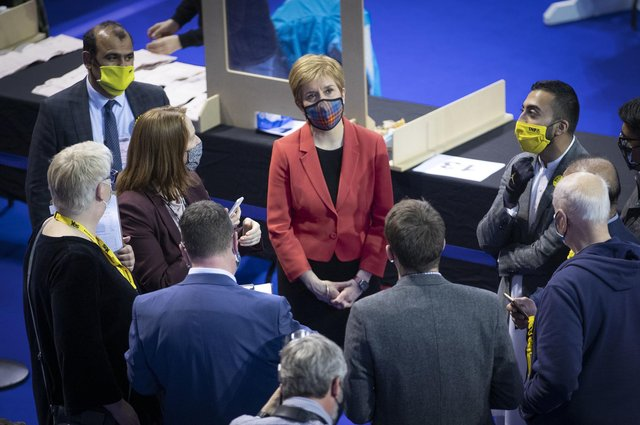Nicola Sturgeon watches the results screen at the count for the Scottish Parliamentary Elections at the Emirates Arena, Glasgow.