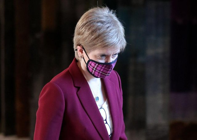 """First Minister Nicola Sturgeon has told Scots she is """"truly sorry"""" for mistakes her administration has made, after the UK's coronavirus death toll surpassed 100,000 on Tuesday. (Photo by Andrew Milligan - Pool/Getty Images)"""