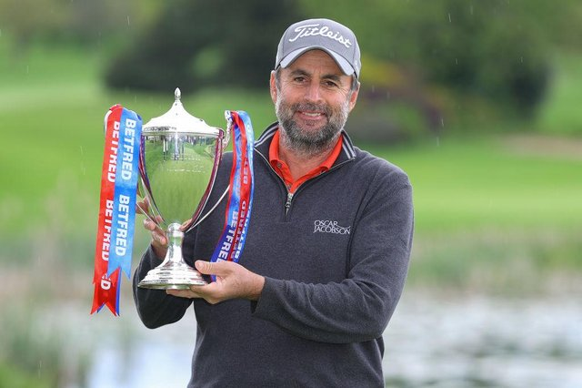 Richard Bland poses with the trophy after winning the Betfred British Masters hosted by Danny Willett at The Belfry. Picture: Richard Heathcote/Getty Images.
