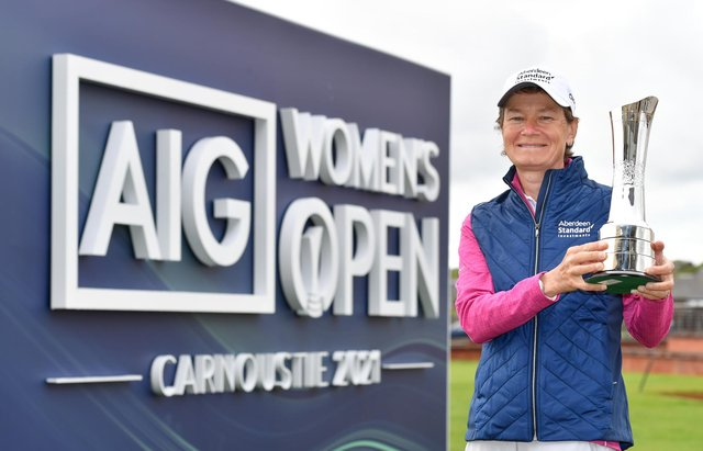 Former winner Catriona Matthew poses with the AIG Women's Open trophy during a visit to Carnoustie ahead of this year's event in August. Picture: Mark Runnacles/Getty Images/R&A.