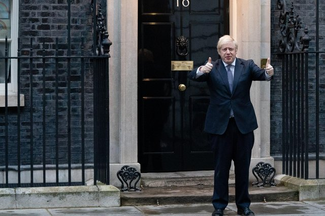 Prime Minister Boris Johnson stands outside 10 Downing Street in London as he joins in the applause to salute local heroes during Thursday's nationwide Clap for Carers