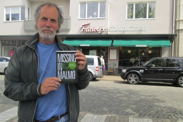 Author Torquil MacLeod outside Fridolfs, Ystad for the launch of the third in the Anita Sundstrom series, Missing in Malmo