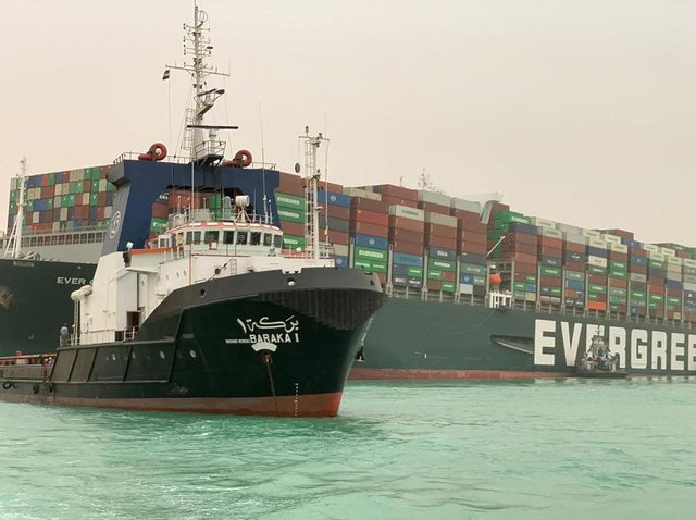A giant container ship ran aground in the Suez Canal after a gust of wind blew it off course, the vessel's operator said on March 24, 2021, bringing marine traffic to a halt along one of the world's busiest trade routes.