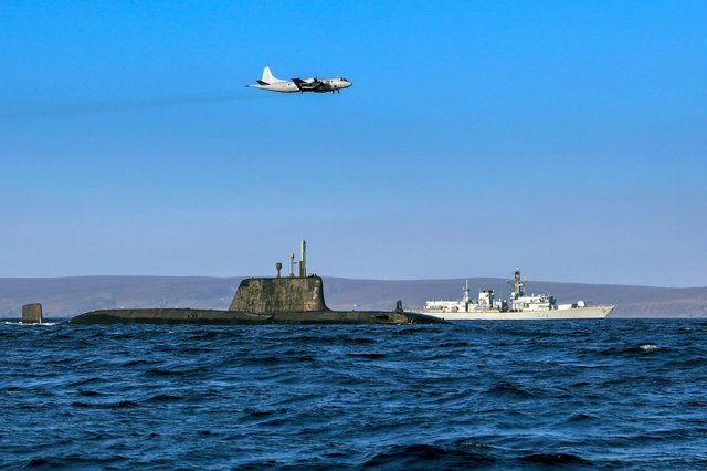 An Astute class nuclear submarine in company with the Type 23 frigate HMS Kent being over flown by a German Navy P3 maritime patrol aircraft (Pic: Royal Navy)