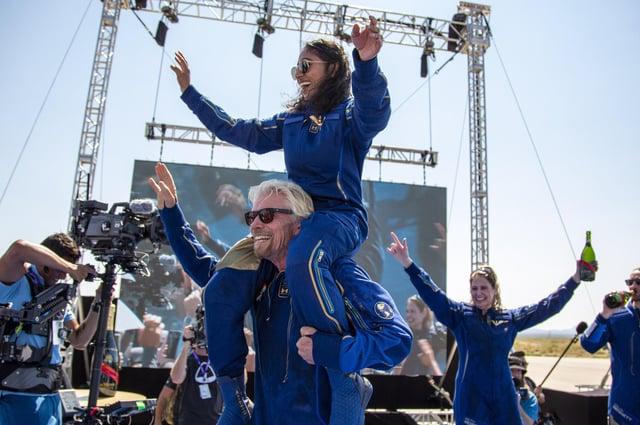 Virgin Galactic founder Richard Branson carries crew member Sirisha Bandla on his shoulders while celebrating their flight to space