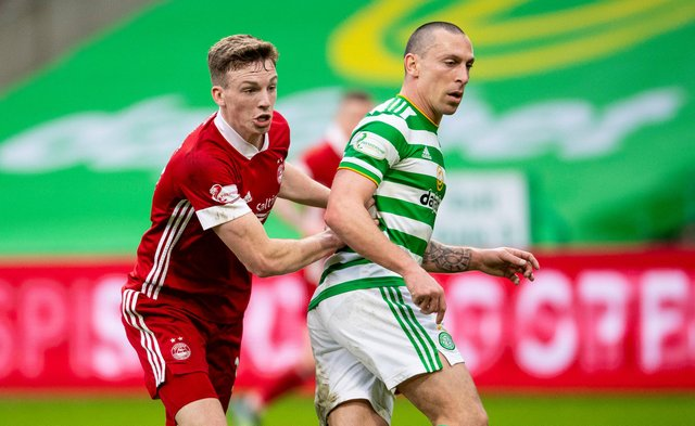 Scott Brown in Celtic colours tussling with  Aberdeen's Lewis Ferguson. The pair will be on the same side next season...with all the strangeness that entails. (Photo by Ross MacDonald / SNS Group)