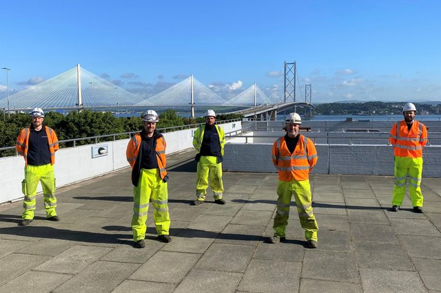 Openreach engineers are pictured at work on the Forth Road Bridge