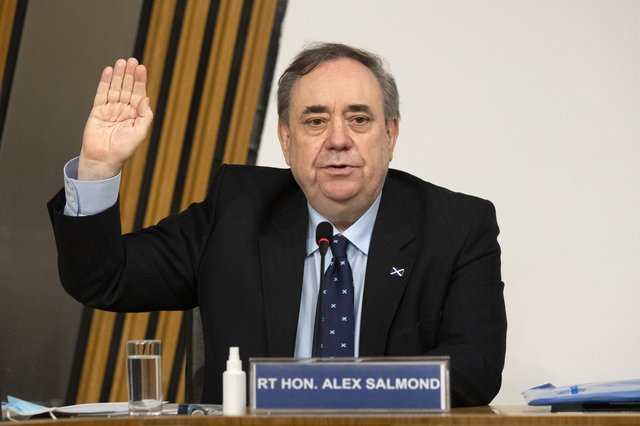 Alex Salmond is sworn in before giving evidence to a Scottish Parliament Harassment committee