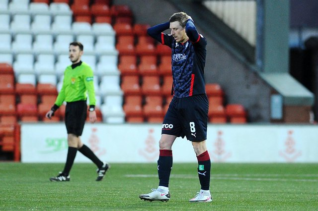 Blair Alston looks to the ground after Airdrie's second goal consigns Falkirk to another year in League One. Picture: Michael Gillen
