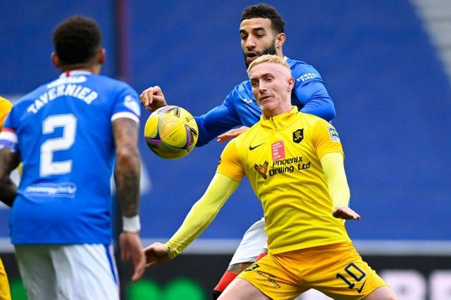 Livingston's Craig Sibbald (centre) holds off Rangers' Connor Goldson during a Scottish Premiership match between Rangers and Livingston at Ibrox Stadium, on October 25, 2020, in Glasgow, Scotland. (Photo by Rob Casey / SNS Group)