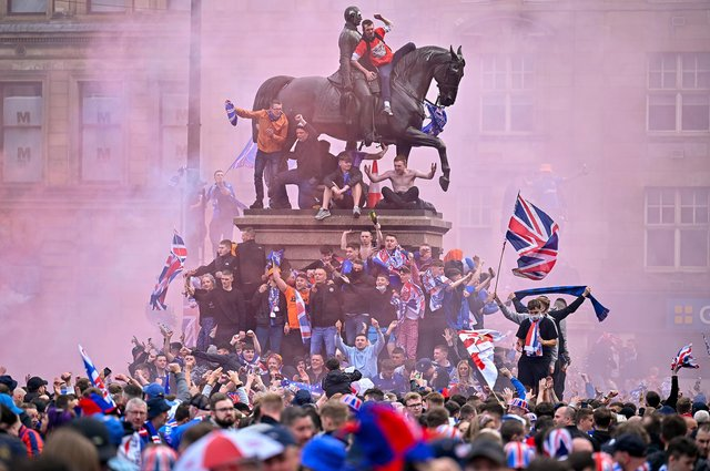 The Rangers title celebrations quickly turned ugly with police officers injured as they struggled to control the mayhem (Picture: Jeff J Mitchell/Getty Images)