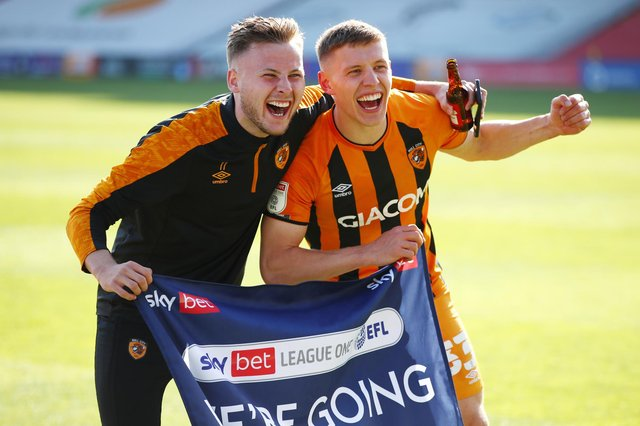 Former Rangers midfielder Greg Docherty (right) celebrates Hull City's promotion with team mate James Scott (Photo by Joe Portlock/Getty Images)