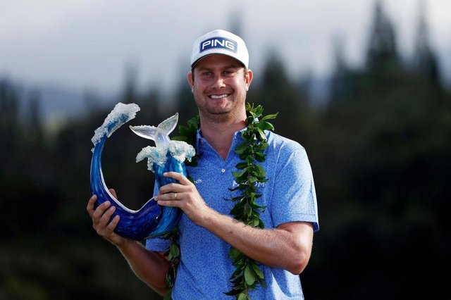 Harris English of the United States poses with the trophy after defeating Joaquin Niemann in a play-off in the Sentry Tournament Of Champions at the Kapalua Plantation Course in Hawaii. Picture: Cliff Hawkins/Getty Images.