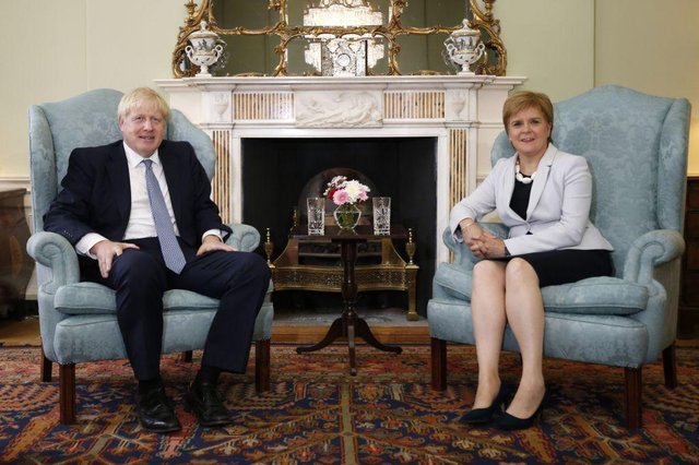 Boris Johnson and Nicola Sturgeon were social distancing long before Covid