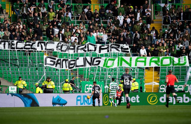 Celtic fans are known for having a pop at the board through banners at matches