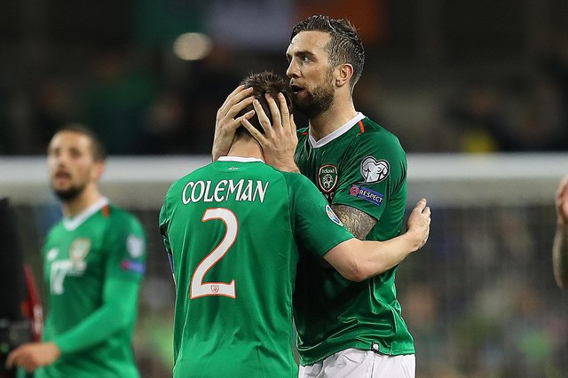 Seamus Coleman and Shane Duffy embrace following the Republic of Ireland's 1-0 win against Georga in March 2019