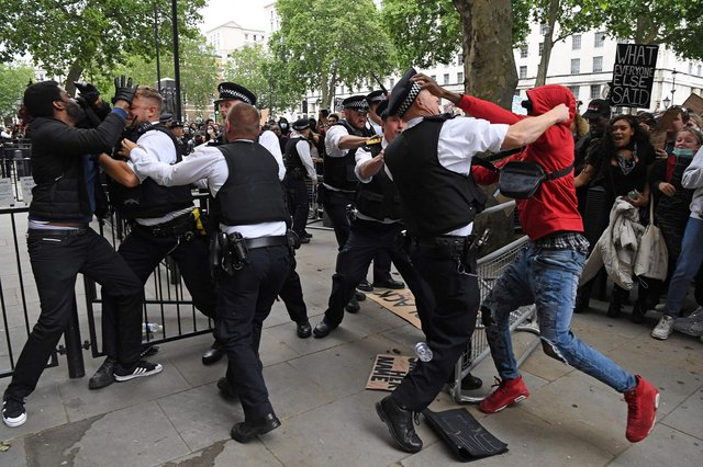 Protestors scuffle with police officers near the entrance to Downing Street during an anti-racism demonstration in London (Picture: Daniel Leal-Olivas/AFP via Getty Images)