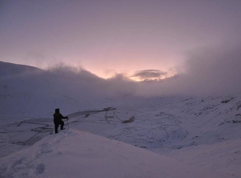 John Lewis Munro caught dawn breaking over a frozen Loch a'Bhealaich in Kintail.