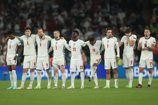 English players dejected in the final penalty shoot out of Euro 2020