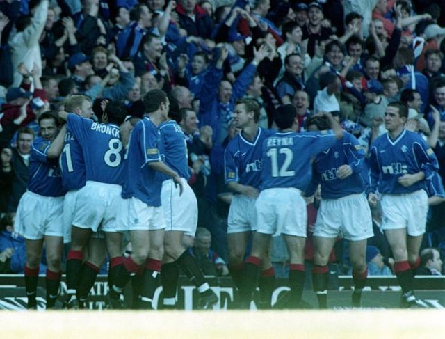 Jorg Albertz is congratulated by his team-mates after scoring for Rangers on March 26, 2000