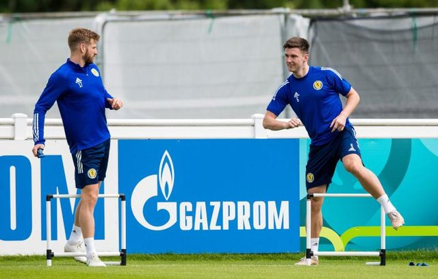 Kieran Tierney (right) returned to full training with the Scotland squad on Thursday and was all smiles as he worked alongside Stuart Armstrong (left). (Photo by Ross Parker / SNS Group)