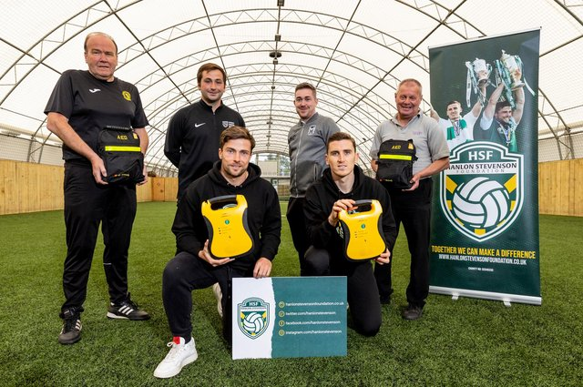 The Hanlon Stevenson Foundation have donated defibrillators to four local youth clubs – Hutchison Vale, Leith Athletic, Salvesen and Street Soccer Scotland. Hibernian duo Lewis Stevenson and Paul Hanlon were at World of Football in Edinburgh to make the presentation. Photo by Alan Rennie