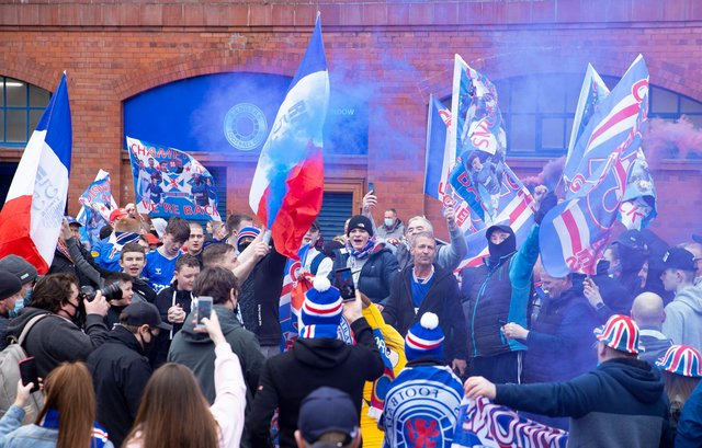 Rangers fans gather outside Ibrox to celebrate title victory. Picture: SNS