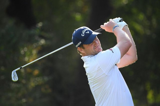 Marc Warren tees off on the fourth hole during Day one of the DP World Tour Championship at Jumeirah Golf Estates last month. Picture: Ross Kinnaird/Getty Images.