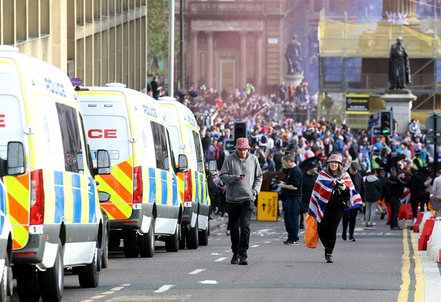 Rangers fans celebrate winning the Scottish Premiership in George Square, Glasgow, after their match against Aberdeen. Picture: PA