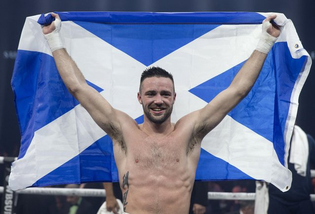 Josh Taylor celebrates beating Ryan Martin during their WBC Silver Championship at The SSE Hydro, Glasgow, in 2018 (Picture: Jeff Holmes/PA)