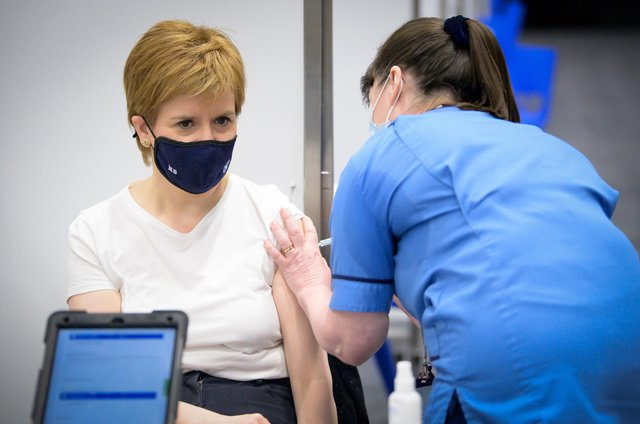 First Minister of Scotland Nicola Sturgeon receives the first shot of the Astra Zeneca vaccine, administered by staff nurse Elaine Anderson, at the NHS Louisa Jordan vaccine centre in the SSE Hydro in Glasgow, Scotland. Picture date: Thursday April 15, 2021.