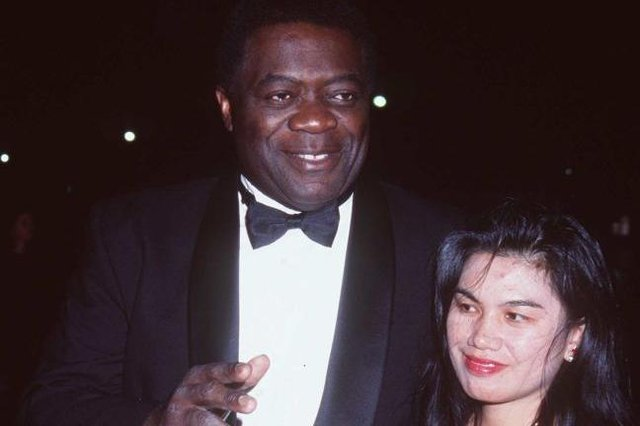 Yaphet Kotto and third wife Tessie Sinahon at the Black American Cinema Society Awards in 1997