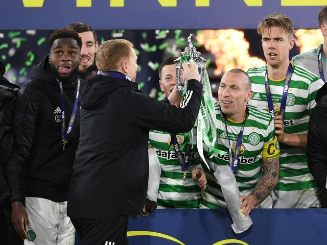 Celtic manager Neil Lennon lifts the 2019/2020 Scottish Cup with captain Scott Brown looking on in the celebrations for a triumph completing a quadruple treble for the club. (Photo by Craig Foy / SNS Group)
