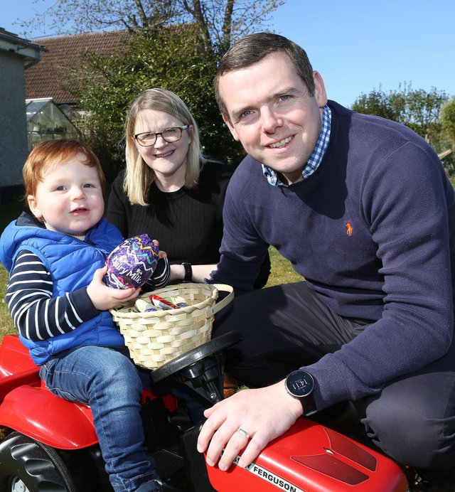 Douglas Ross, his wife Krystle and their son Alistair.