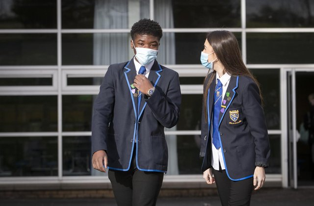 Head boy Jordy Yahve and head girl Orla Irvine head for lessons at St Andrew's RC Secondary School in Glasgow as more pupils are returning to school in Scotland in the latest phase of lockdown easing last month.