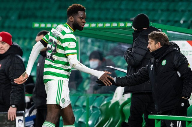 Odsonne Edouard shakes hands with Celtic coach Gavin Strachan after being substituted late in Wednesday's win. Picture: SNS