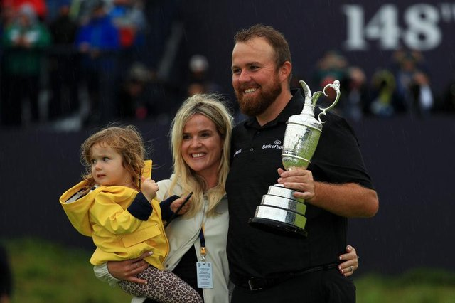 Shane Lowry celebrates his 2019 Open win at Royal Portrush with wife Wendy and daughter Iris. Picture: Mike Ehrmann/Getty Images.